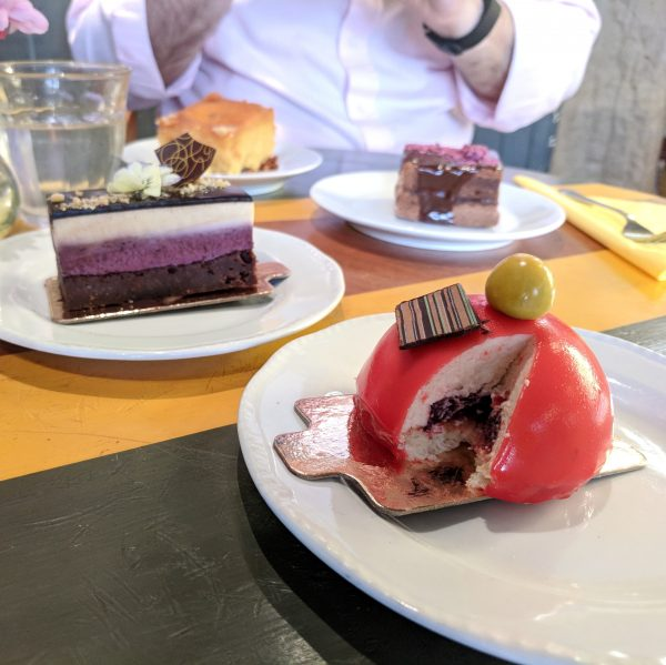 All the cake. In front, peach and raspberry mousse, blueberry and white chocolate, sacher on a crunchy base and, closest to Christopher, heavenly orange and polenta.