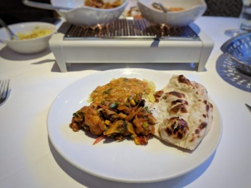 Mains for an autum nevening: subtle seasonal vegetable curry with naan,, pilao and tadka daal. Mumbai Diner's Club.