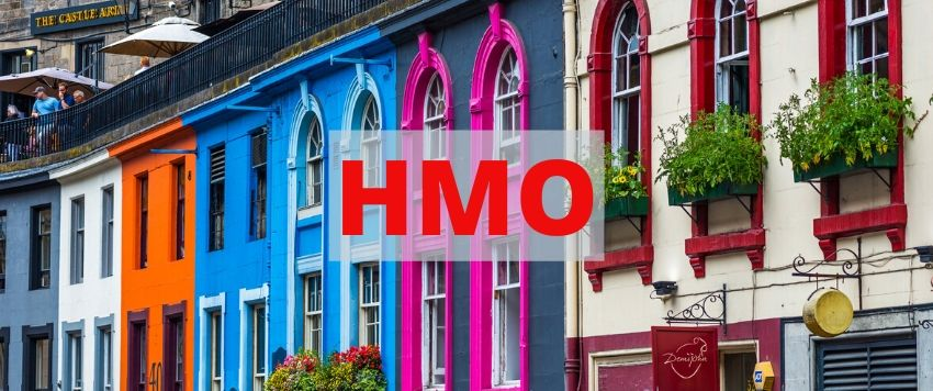 Colorful street in Edinburgh Old Town with a big HMO title.