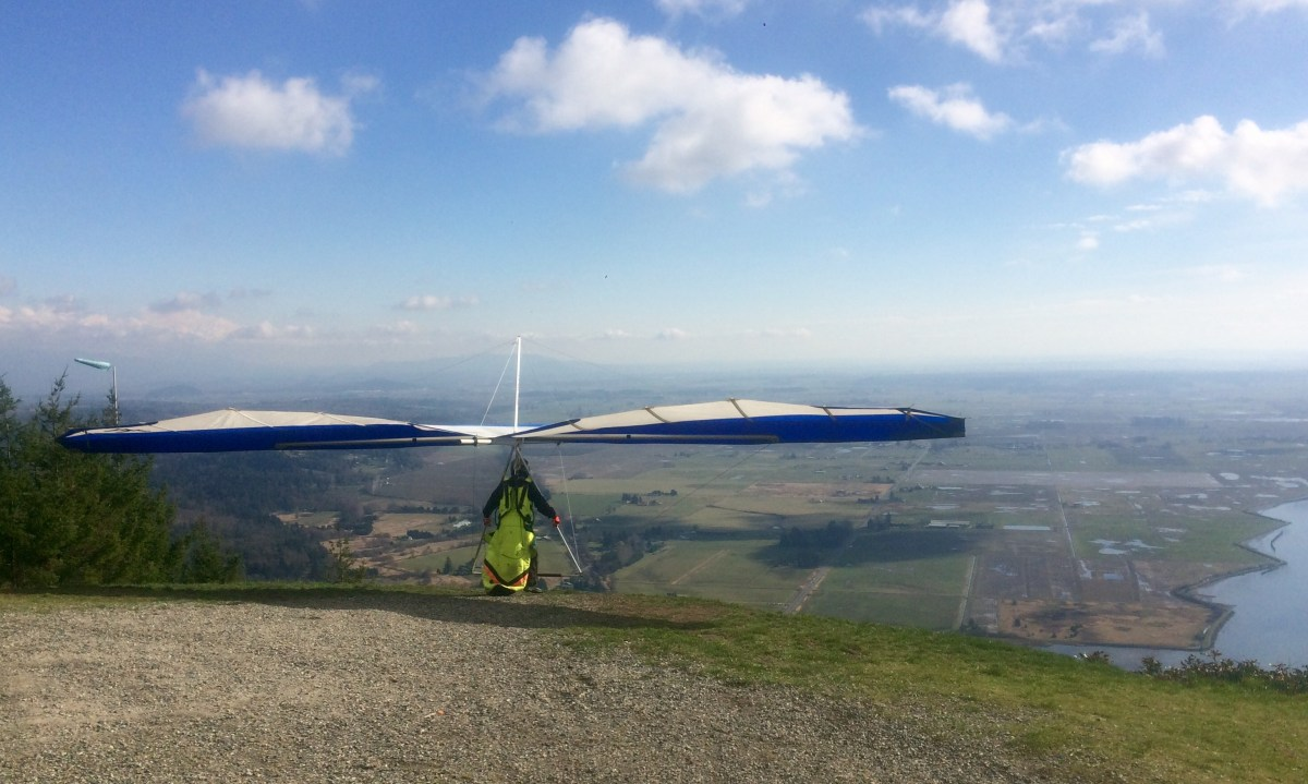 A hang glider gets ready to launch from Samish Overlook