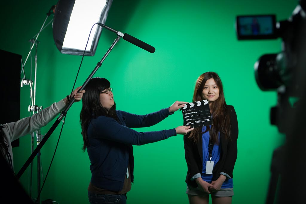 Students on shoot on greenscreen set