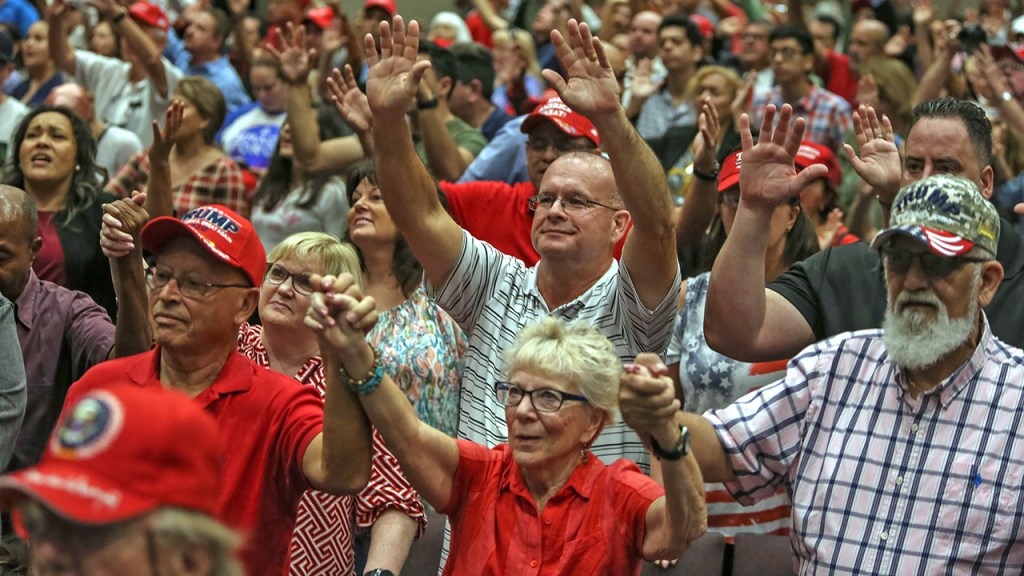 MIAMI, UNITED STATES - JANUARY 03, 2020: Evangelical supporters of Donald Trump are being led in prayers inside the El Rey Jesus church. President Donald Trump holds an Evangelicals for Trump rally at the El Rey Jesus megachurch in south Miami to show up support among his evangelical base in the key swing state of Florida.- PHOTOGRAPH BY Adam DelGiudice / Echoes Wire/ Barcroft Media (Photo credit should read Adam DelGiudice / Echoes Wire / Barcroft Media via Getty Images)