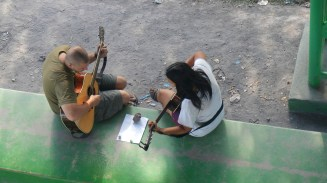 Michelle trying to teach me guitar