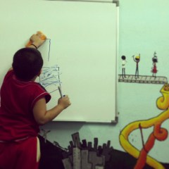 Student drawing something on board