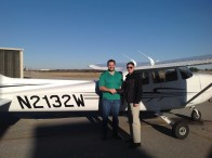 My instructor, Jon, and I upon completion of my first solo flight.