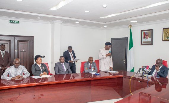 The Special Adviser to the Edo State Governor on Strategic Planning and Chairman of the organising committee for the Alaghodaro Investment Summit, Prof. Julius Ihonvbere (standing) addressing Governor Godwin Obaseki of Edo State (1st right); the Chief of Staff to the Edo State Governor, Mr. Taiwo Akerele (3rd right) and other members of the committee during the inauguration ceremony at the Government House in Benin City, on Wednesday, October 25, 2017.
