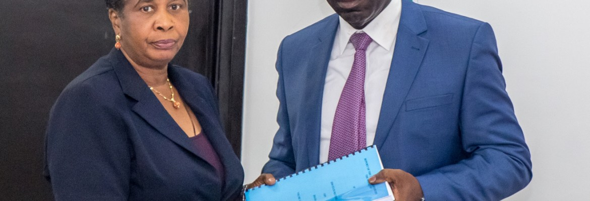 Chairman of the Committee of Enquiry on the Edo State Polytechnic, Usen, Prof. Rosemary Egonmwan (left) presenting the report to Governor Godwin Obaseki, at the Government House, Benin City.