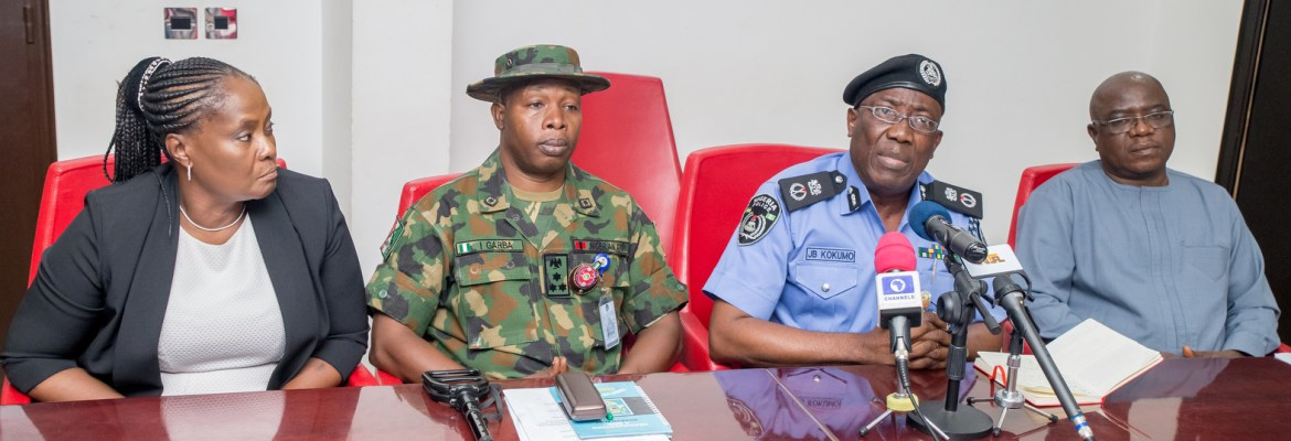 Commissioner of Police, Edo State Command, M. Johnson Kokumo, speaking after a joint security meeting at the Government House, Benin City, on Monday. With him are; the Commander, 4th Brigade, Nigeria Army, Benin, Brigadier General Ibrahim Garba (2nd left); Edo State Attorney General and Commissioner for Justice, Hon. Prof. Yinka Omorogbe (left); and State Director, Department of State Security, Mr. Ibrahim Halilu (right)