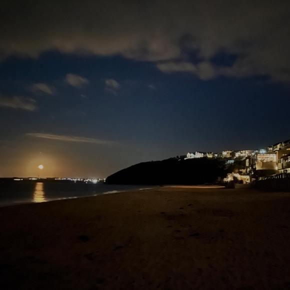 Harvest moon on the beach