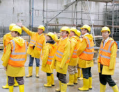 Group of people in hard hats