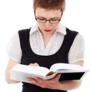 woman in glasses reading book