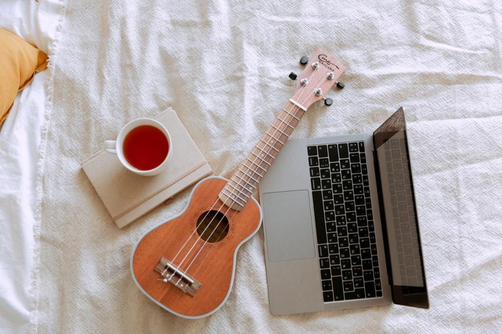 top view of morning learning ukulele play process in bed 3975591