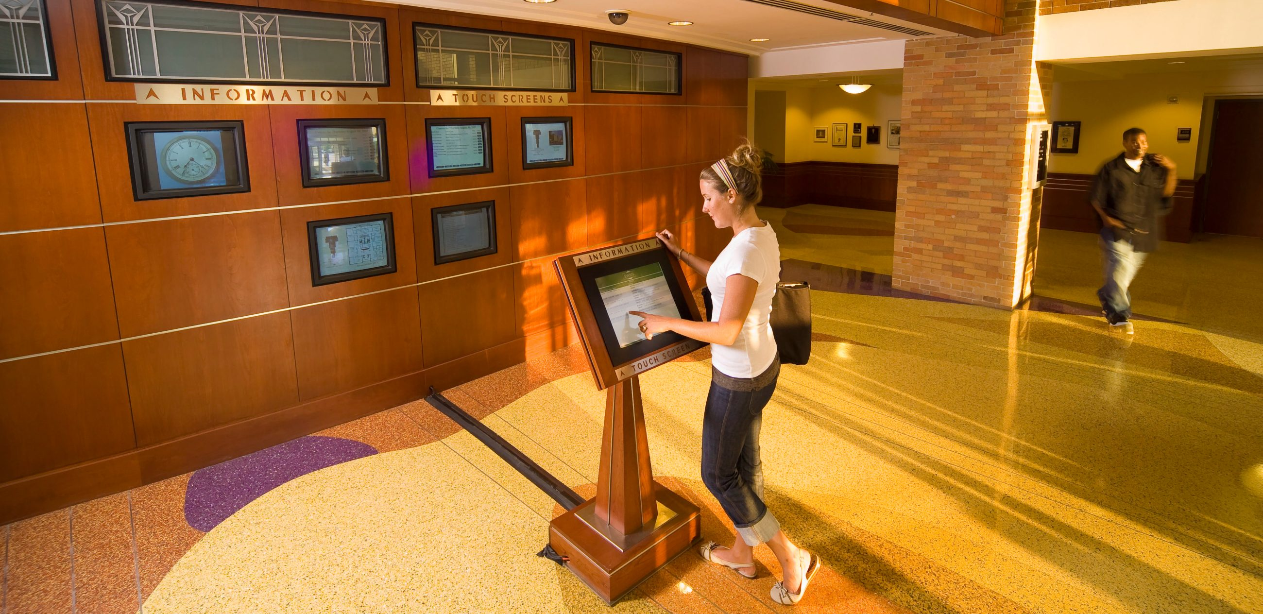 Woman using a touch-screen information kiosk