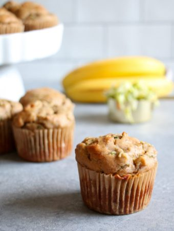 Gluten-free banana and zucchini muffins on a gray background.