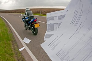 Biker driving away from Paperwork