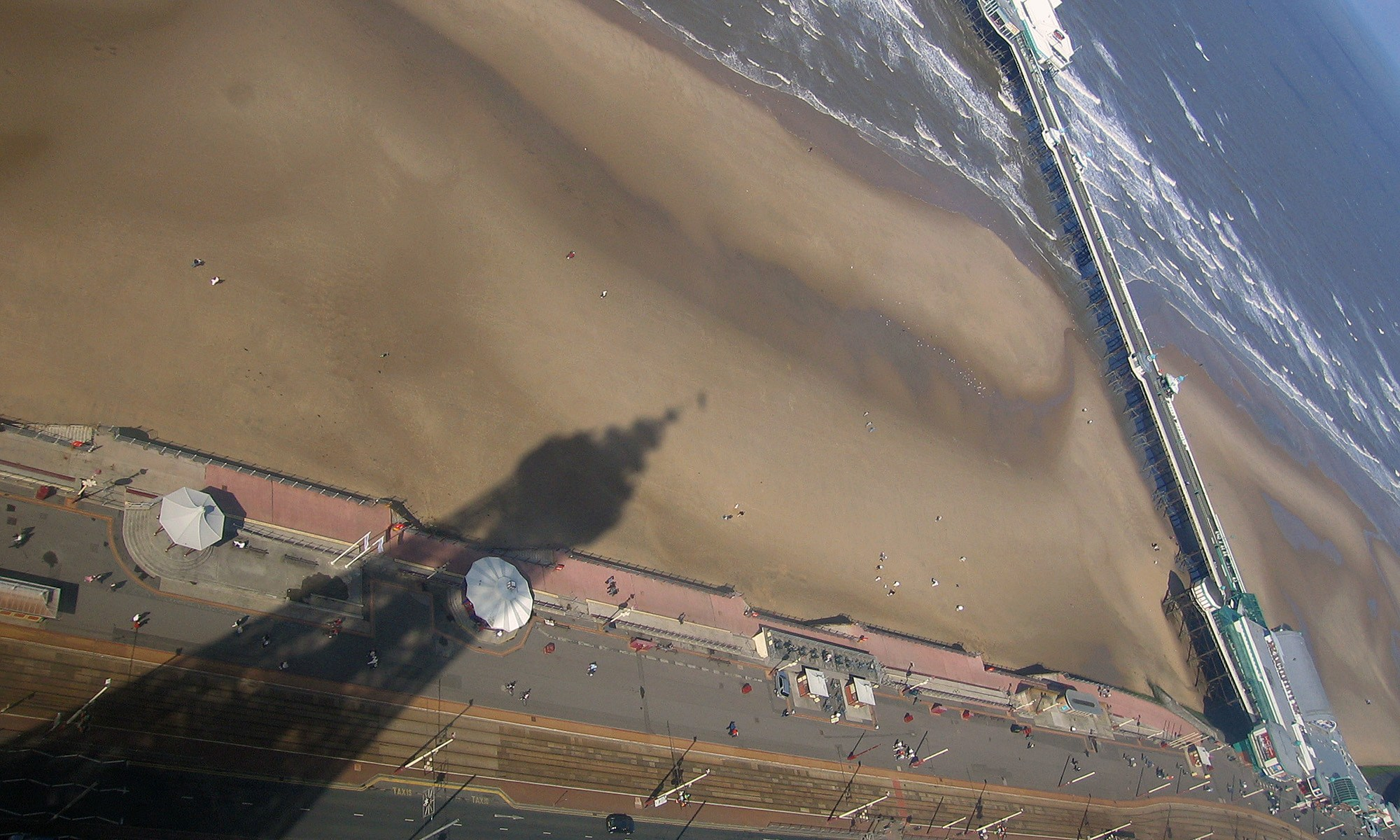Blackpool Tower Shadow on the Beach with North Pier