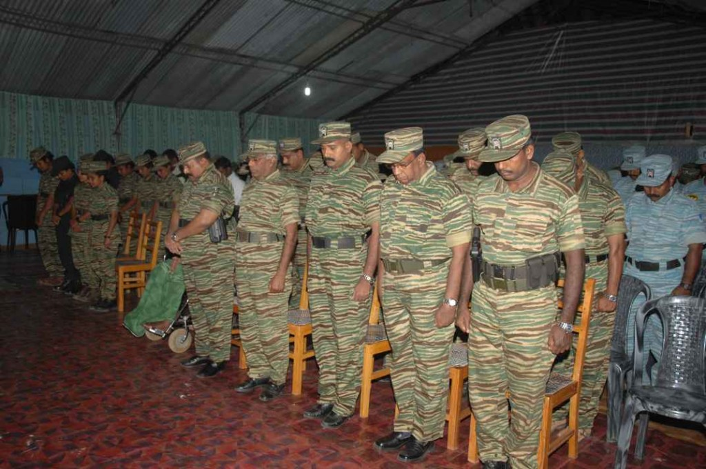 LTTE leader with Tiger commanders and officials, paying homage to the fallen Black Tigers on the attack on Sri Lankan Vanni SF HQ.