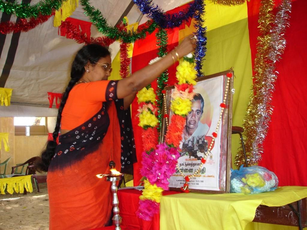 Ms. Pathmini Sithamparanathan garlanding Annai Poopathy's image
