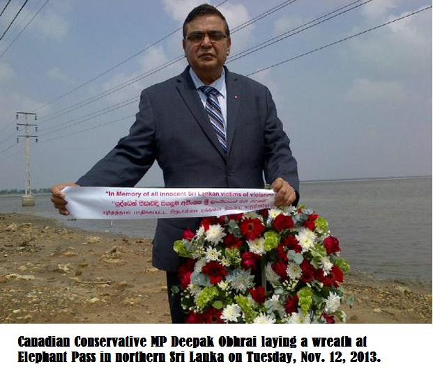 Canadian Conservative MP Deepak Obhrai laying a wreath at Elephant Pass in northern Sri Lanka on Tuesday, Nov. 12, 2013.