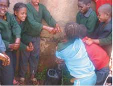 Children using an ABE water-point