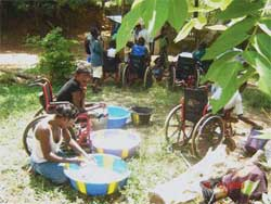 Children help each other with washing clothes