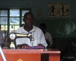 Learning tailoring in Tanzania (EENET photo library)