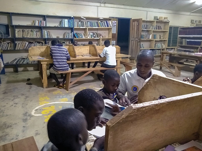 Parents and children in a library in Ghana