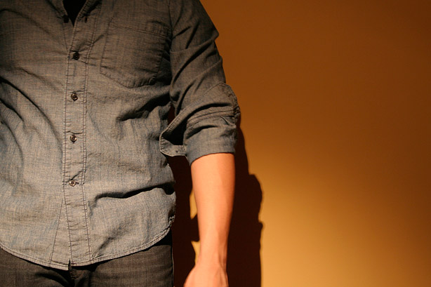 Grab the cuff and while in the process of folding up once, pull up towards your shoulder.