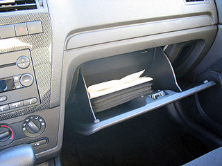 Car owner's manual in a glove box - picture by Q4RadioGuy