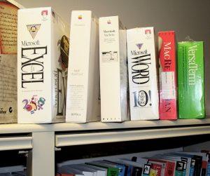 bookshelf featuring obsolete software files