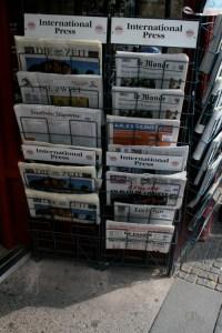 rack of international newspapers