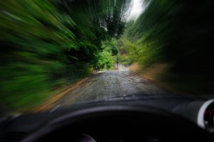blurred scene from speeding car