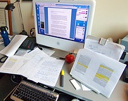 desk covered in research papers