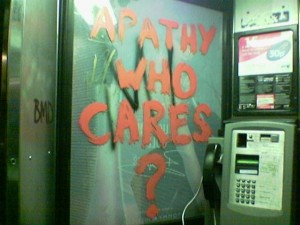 graffiti in telephone kiosk reading 'Apathy who cares?'
