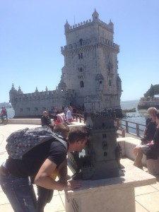 An adult tourist explores the tower end of the model