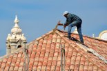 Man fixing roof