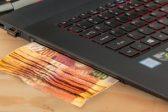cash under laptop