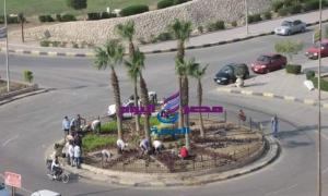 (تطوير الجزيرة الوسطى بالمدخل الشمالى فى مدينة 15 مايو)