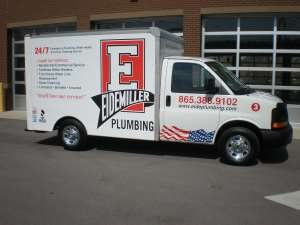 a close up of an eidemiller plumbing truck