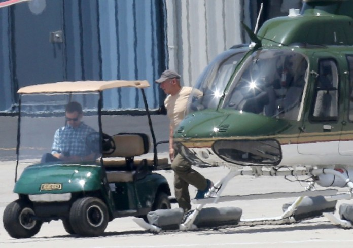 Harrison Ford is pictured for the first time flying in a private helicopter and gets a hug as he leaves the airport.