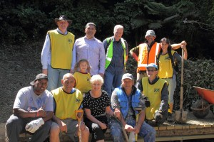 Planting, trail blazing, blackberry eradication and planting in 2013 with local rangers, politicians and a few volunteers. (Eileen is far right, back row)