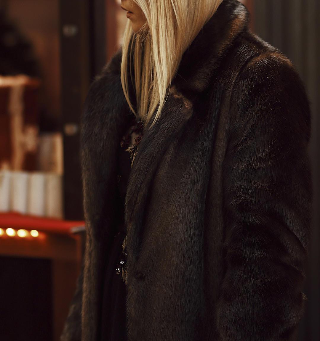 Blonde Girl wear faux fur winter coat from Monsoon Fashion