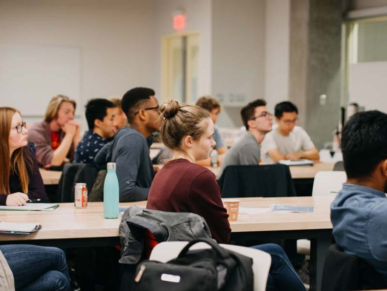 A room of engineering students listen while David Cory explains some of the fundamentals of emotional intelligence training.