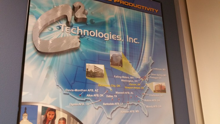 A poster outside the conference room pictured above illustrated C2 Technologies' office locations.