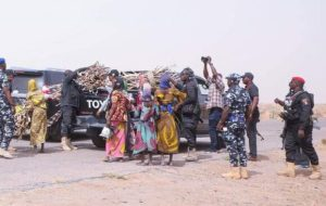 PHOTOS: Nigerian Governor Stops Convoy To Assist Women Fetching Firewood