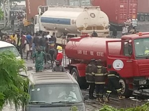 Residents Scoop Fuel As Fully-Loaded Tanker Falls In Lagos (Photos)