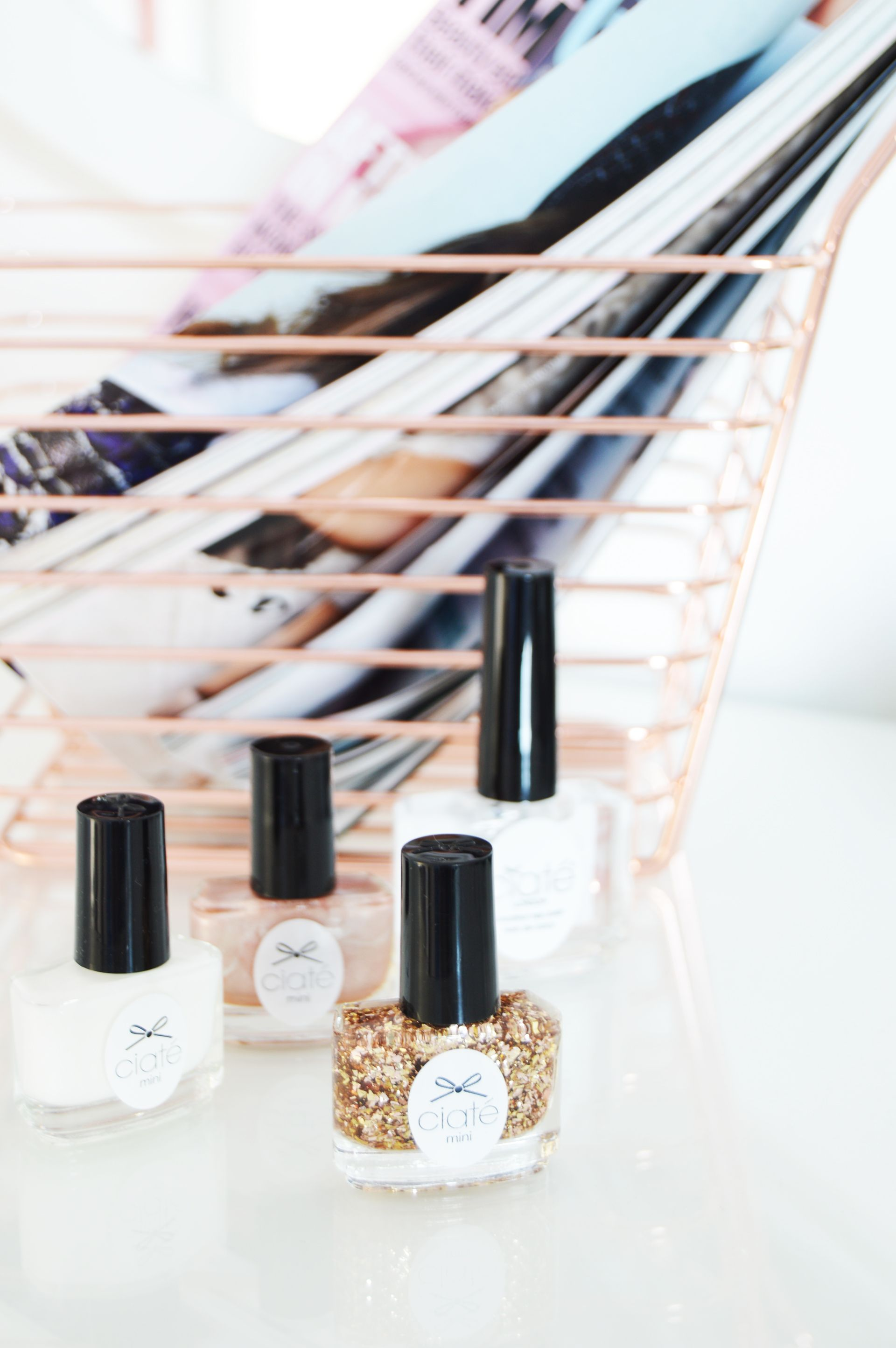 Ciate London South Beach Socialite Nail Polish set has 3 mini nail polishes and 1 full-size coconut scented topcoat. These colours are perfect for summer days and will look flattering on any skin.