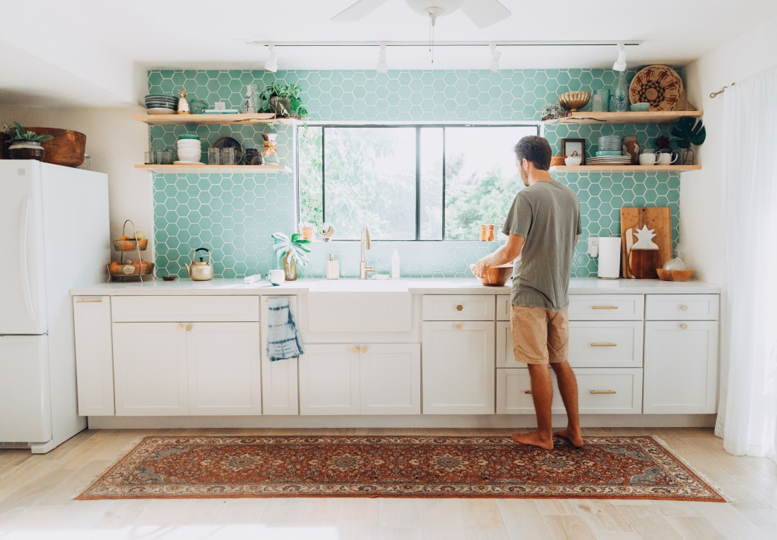 Kitchen Renovation Reveal | Tropical, Modern, Bohemian Kitchen | Aqua Blue Hexagon Tile Backsplash | Unique Kitchen | Tropical Kitchen | Hawaiian Home Renovation Reveal | White Cabinets with Brass Hardware | Hexagon Brass Cabinet Pulls | Eclectic Kitchen Style | Shibori Towels | Open Shelving via @elanaloo + elanaloo.com