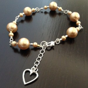 Peach pearl and chain link necklace with heart-shaped pendant weight