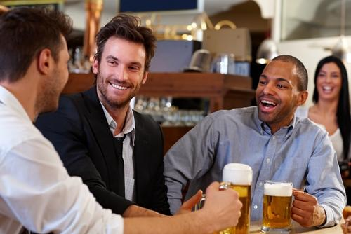men-friends-drinking-alcohol-and-smiling